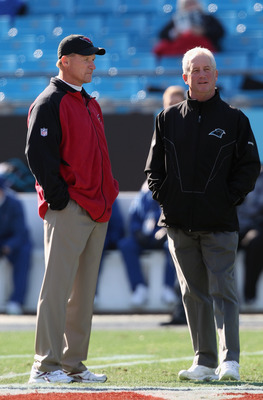 CHARLOTTE, NC - DECEMBER 19:  Head coach Ken Whisenhunt of the Arizona Cardinals talks with head coach John Fox of the Carolina Panthers before the start of their game at Bank of America Stadium on December 19, 2010 in Charlotte, North Carolina.  (Photo b