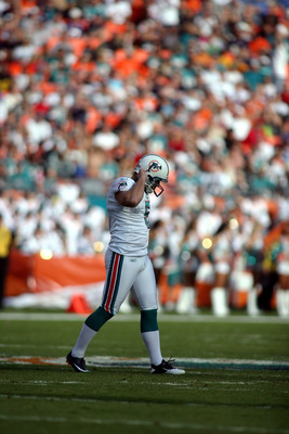 MIAMI, FL - DECEMBER 19: Kicker Dan Carpenter #5 of the Miami Dolphins reacts to missing a field goal late in the game against the Buffalo Bills at Sun Life Stadium on December 19, 2010 in Miami, Florida. The Bills defeated the Dolphins 17-14.  (Photo by