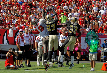 TAMPA, FL - OCTOBER 17:  Defenders Malcolm Jenkins #27 and Jabari Greer #33 of the New Orleans Saints break up a pass intended for Mike Williams #19 of the Tampa Bay Buccaneers during the game at Raymond James Stadium on October 17, 2010 in Tampa, Florida