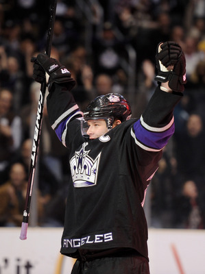 LOS ANGELES, CA - DECEMBER 11:  Dustin Brown #23 of the Los Angeles Kings celebrates his goal against the Minnesota Wild during the game at the Staples Center on December 11, 2010 in Los Angeles, California.  (Photo by Harry How/Getty Images)