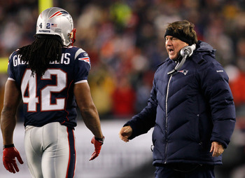 FOXBORO, MA - DECEMBER 06:  Head coach Bill Belichick of the New England Patriots congratulates BenJarvus Green-Ellis #42 after Green-Ellis scored a 5-yard rushing touchdown in the fourth quarter against the New York Jets at Gillette Stadium on December 6