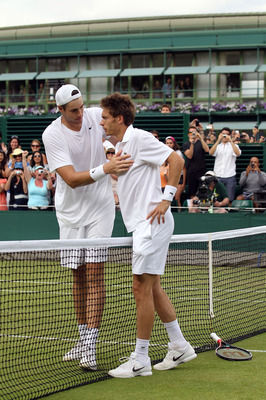 LONDON, ENGLAND - JUNE 24:  Nicolas Mahut of France (R) after losing on the third day of his first round match against John Isner of USA on Day Four of the Wimbledon Lawn Tennis Championships at the All England Lawn Tennis and Croquet Club on June 24, 201