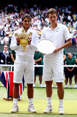 LONDON, ENGLAND - JULY 04:  Rafael Nadal of Spain (L) holds the Championship trophy after winning the Men's Singles Final match against Tomas Berdych of Czech Republic (R) on Day Thirteen of the Wimbledon Lawn Tennis Championships at the All England Lawn