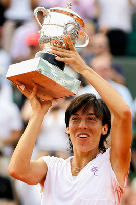 PARIS - JUNE 05:  Francesca Schiavone of Italy celebrates with the trophy after winning the women's singles final match between Francesca Schiavone of Italy and Samantha Stosur of Australia on day fourteen of the French Open at Roland Garros on June 5, 20