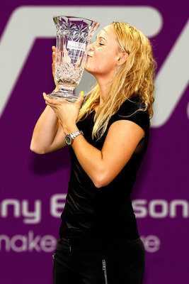 DOHA, QATAR - OCTOBER 29:  Caroline Wozniacki of Denmark poses for photographers after receiving a trophy for finishing the year first in the WTA rankings during day four of the WTA Championships at the Khalifa Tennis Complex on October 29, 2010 in Doha,