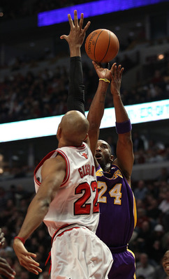 CHICAGO, IL - DECEMBER 10: Kobe Bryant #24 of the Los Angeles Lakers puts up a shot over Taj Gibson #22 of the Chicago Bulls at the United Center on December 10, 2010 in Chicago, Illinois. The Bulls defeated the Lakers 88-84. NOTE TO USER: User expressly