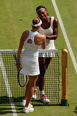LONDON, ENGLAND - JULY 03:  Serena Williams of USA (R) shakes hands after winning her Ladies Singles Final Match against Vera Zvonareva of Russia on Day Twelve of the Wimbledon Lawn Tennis Championships at the All England Lawn Tennis and Croquet Club on J