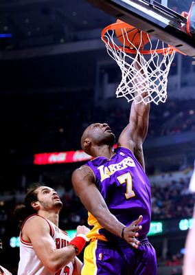 CHICAGO, IL - DECEMBER 10: Lamar Odom #7 of the Los Angeles Lakers puts up a shot over Joakim Noah #13 of the Chicago Bulls at the United Center on December 10, 2010 in Chicago, Illinois. The Bulls defeated the Lakers 88-84. NOTE TO USER: User expressly a