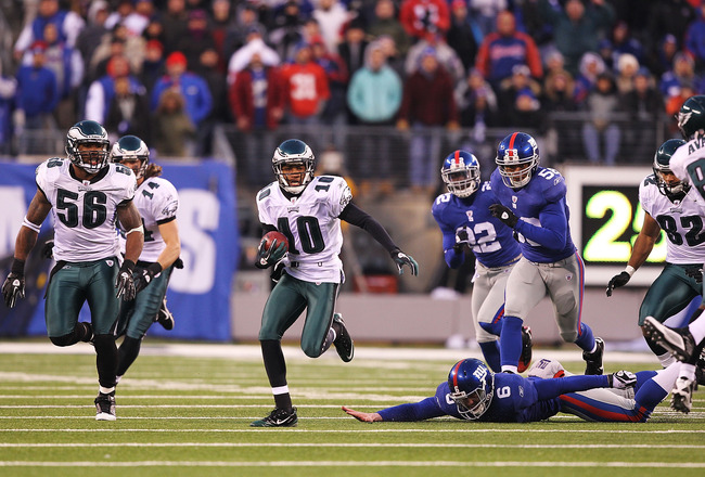 EAST RUTHERFORD, NJ - DECEMBER 19:  DeSean Jackson #10 of the Philadelphia Eagles eludes Matt Dodge #6 of the New York Giants and returns a punt for the winning touchdown as time runs out defeating the Giants 38-31 during their game on December 19, 2010 a