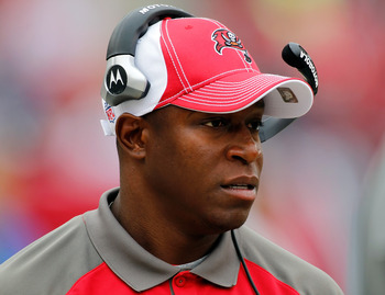 TAMPA, FL - DECEMBER 19:  Head coach Raheem Morris of the Tampa Bay Buccaneers directs his team against the Detroit Lions during the game at Raymond James Stadium on December 19, 2010 in Tampa, Florida.  (Photo by J. Meric/Getty Images)