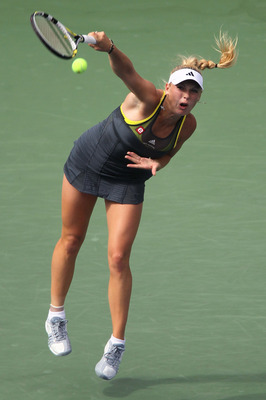 NEW YORK - SEPTEMBER 10:  Caroline Wozniacki of Denmark serves against Vera Zvonareva of Russia during her women's semifinal match on day twelve of the 2010 U.S. Open at the USTA Billie Jean King National Tennis Center on September 10, 2010 in the Flushin