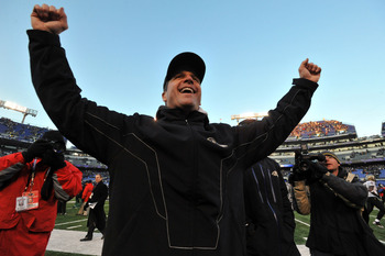 BALTIMORE, MD - DECEMBER 19:  Head coach John Harbaugh of the Baltimore Ravens celebrates the Ravens victory as he walks off the field after the game against the New Orleans Saints  at M&T Bank Stadium on December 19, 2010 in Baltimore, Maryland. The Rave
