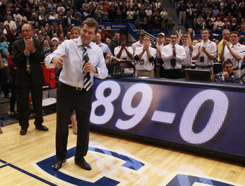 HARTFORD, CT - DECEMBER 21:  Coach Geno Auriemma of Connecticut celebrates a win over  Florida State on December 21, 2010 in Hartford, Connecticut.  Connecticut set a record with 89 straight wins without a defeat. (Photo by Jim Rogash/Getty Images)