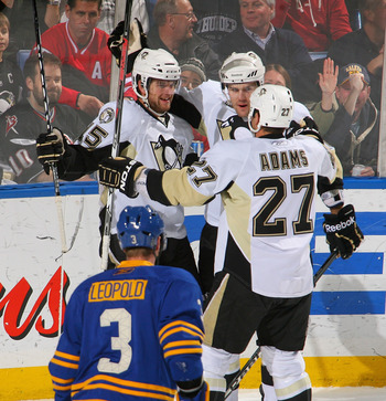 BUFFALO, NY - DECEMBER 11: Dustin Jeffrey #15, Ben Lovejoy #6 and Craig Adams #27  of the Pittsburgh Penguins  celebrate Jeffrey's goal in the first period against the Buffalo Sabres  at HSBC Arena on December 11, 2010 in Buffalo, New York.  (Photo by Ric