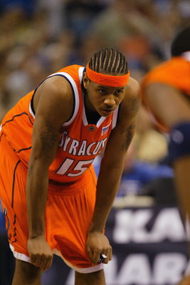 NEW ORLEANS - APRIL 7:  Carmelo Anthony #15 of Syracuse waits for free throws to be shot by Kansas during the championship game of the NCAA Men's Final Four Tournament on April 7, 2003 at the Louisiana Superdome in New Orleans, Louisiana.  Syracuse defeat