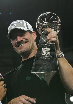 DETROIT - FEBRUARY 05:  Head coach Bill Cowher of the Pittsburgh Steelers celebrates with the Vince Lombardi Tropy after defeating the Seattle Seahawks in Super Bowl XL at Ford Field on February 5, 2006 in Detroit, Michigan.The Steelers defeated the Seaha