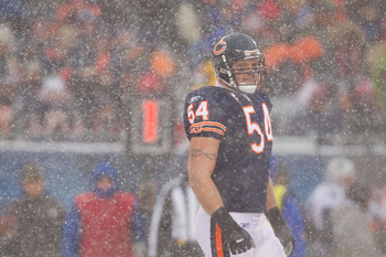 CHICAGO, IL - DECEMBER 12: Brian Urlacher #54 of the Chicago Bears looks to the sideline in between plays against the New England Patriots at Soldier Field on December 12, 2010 in Chicago, Illinois.  The Patriots beat the Bears 36-7.  (Photo by Dilip Vish