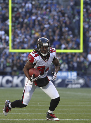 SEATTLE, WA - DECEMBER 19:  Wide receiver Roddy White #84 of the Atlanta Falcons rushes against the Seattle Seahawks at Qwest Field on December 19, 2010 in Seattle, Washington. The Falcons defeated the Seahawks 34-18. (Photo by Otto Greule Jr/Getty Images