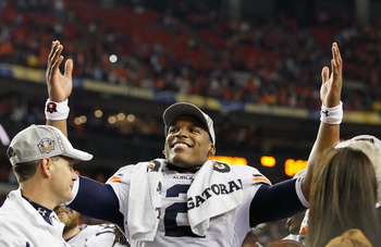 ATLANTA, GA - DECEMBER 04:  Quarterback Cam Newton #2 of the Auburn Tigers celebrates after their 56-17 win over the South Carolina Gamecocks during the 2010 SEC Championship at Georgia Dome on December 4, 2010 in Atlanta, Georgia.  (Photo by Kevin C. Cox