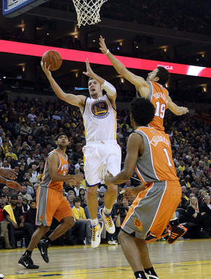 OAKLAND, CA - DECEMBER 02:  David Lee #10 of the Golden State Warriors in action against the Phoenix Suns at Oracle Arena on December 2, 2010 in Oakland, California. NOTE TO USER: User expressly acknowledges and agrees that, by downloading and or using th