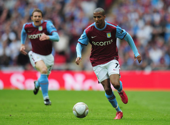 LONDON, ENGLAND - APRIL 10:  Ashley Young of Aston Villa runs with the ball as team mate Stephen Warnock supports during the FA Cup sponsored by E.ON Semi Final match between Aston Villa and Chelsea at Wembley Stadium on April 10, 2010 in London, England.