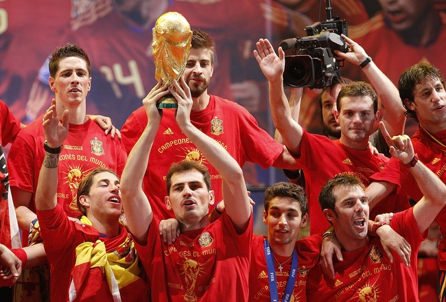 MADRID, SPAIN - JULY 12:  Iker Casillas of Spanish national football team holds the trophy during the Spanish team's victory parade following their victory over the Netherlands in the 2010 FIFA World Cup on July 12, 2010 in Madrid, Spain.  (Photo by Angel