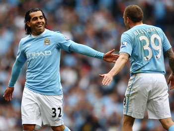 MANCHESTER, ENGLAND - APRIL 11:  Carlos Tevez of Manchester City and Craig Bellamy smile during the Barclays Premier League match between Manchester City and Birmingham City at Eastlands, City of Manchester Stadium on April 11, 2010 in Manchester, England