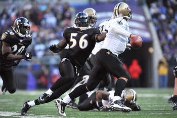 BALTIMORE, MD - DECEMBER 19:  Tavares Gooden #56 of the Baltimore Ravens chases Drew Brees #9 of the New Orleans Saints  at M&T Bank Stadium on December 19, 2010 in Baltimore, Maryland. The Ravens defeated the Saints 30-24. (Photo by Larry French/Getty Im