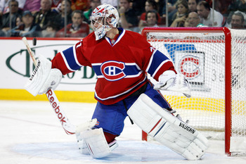 MONTREAL, CANADA - DECEMBER 16:  Carey Price #31 of the Montreal Canadiens makes a blocker save on the puck during the NHL game against the Boston Bruins at the Bell Centre on December 16, 2010 in Montreal, Quebec, Canada.  The Canadiens defeated the Brui