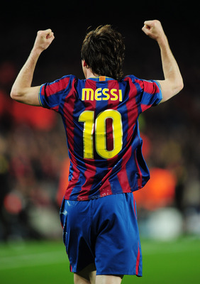 BARCELONA, SPAIN - APRIL 06:  Lionel Messi of Barcelona celebrates scoring his second goal during the UEFA Champions League quarter final second leg match between Barcelona and Arsenal at Camp Nou on April 6, 2010 in Barcelona, Spain.  (Photo by Shaun Bot