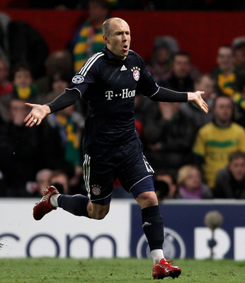 MANCHESTER, ENGLAND - APRIL 07:  Arjen Robben of Bayern Muenchen celebrates scoring his team's second goal during the UEFA Champions League Quarter Final second leg match between Manchester United and Bayern Muenchen at Old Trafford on April 7, 2010 in Ma