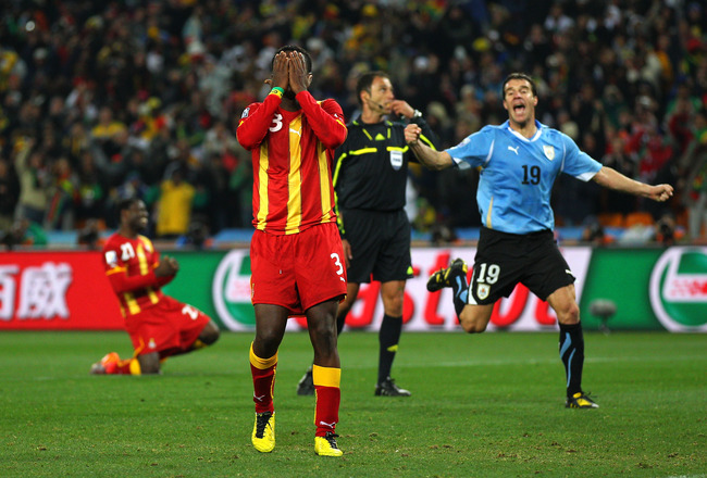 JOHANNESBURG, SOUTH AFRICA - JULY 02:  Asamoah Gyan of Ghana reacts as he misses a late penalty kick in extra time to win the match during the 2010 FIFA World Cup South Africa Quarter Final match between Uruguay and Ghana at the Soccer City stadium on Jul