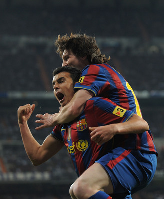 MADRID, SPAIN - APRIL 10:  Pedro Rodriguez of Barcelona celebrates beside Lionel Messi after scoring Barcelona's second goal during the La Liga match between Real Madrid and Barcelona at the Estadio Santiago Bernabeu on April 10, 2010 in Madrid, Spain.  (