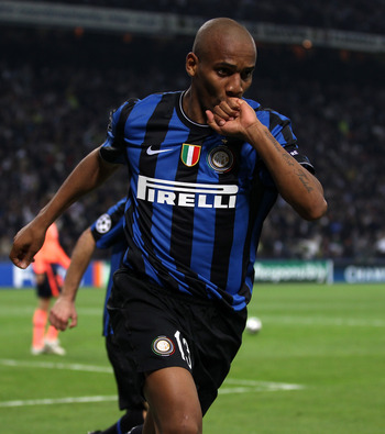 MILAN, ITALY - APRIL 20:  Maicon of Inter celebrates scoring his teams second goal during the UEFA Champions League Semi Final 1st Leg match between Inter Milan and Barcelona at the San Siro on April 20, 2010 in Milan, Italy.  (Photo by Julian Finney/Gett