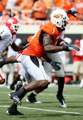 STILLWATER, OK - SEPTEMBER 5:  Wide receiver Dez Bryant #1 of the Oklahoma State Cowboys carries for an 18-yard return during the second quarter of the game against the Georgia Bulldogs at Boone Pickens Stadium on September 5, 2009 in Stillwater, Oklahoma