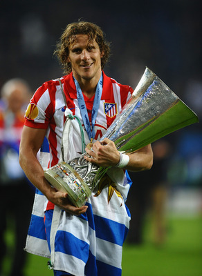 HAMBURG, GERMANY - MAY 12: Diego Forlan of Atletico Madrid holds the UEFA Europa League trophy following his team's victory after extra time at the end of the UEFA Europa League final match between Atletico Madrid and Fulham at HSH Nordbank Arena on May 1