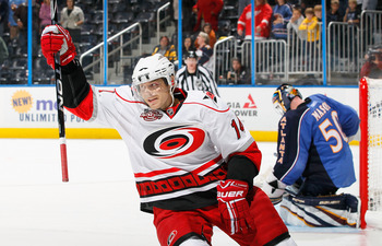 ATLANTA, GA - DECEMBER 16:  Sergei Samsonov #14 of the Carolina Hurricanes reacts after scoring a shootout goal past goaltender Chris Mason #50 of the Atlanta Thrashers to give the Hurricanes a 3-2 win in a shootout at Philips Arena on December 16, 2010 i