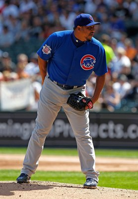 CHICAGO - JUNE 25: Starting pitcher Carlos Zambrano #38 of the Chicago Cubs looks for the catcher's signs in the 1st inning against the Chicago White Sox at U.S. Cellular Field on June 25, 2010 in Chicago, Illinois. Zambrano was suspended indefinitely by