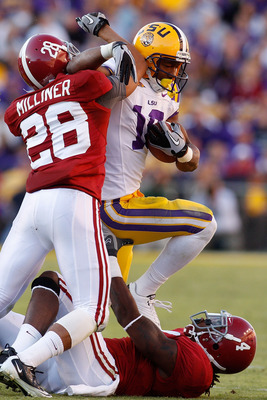 BATON ROUGE, LA - NOVEMBER 06:  Richard Murphy #18 of the Louisiana State University Tigers is tackled by DeMarcus Milliner #28 and Mark Barron #4 of the Alabama Crimson Tide at Tiger Stadium on November 6, 2010 in Baton Rouge, Louisiana. The Tigers defea