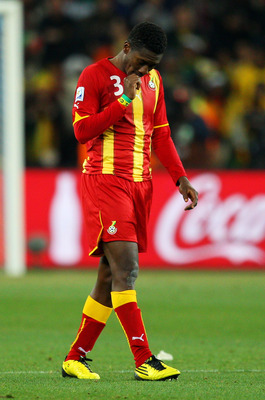 JOHANNESBURG, SOUTH AFRICA - JULY 02: Asamoah Gyan of Ghana looks dejected after the 2010 FIFA World Cup South Africa Quarter Final match between Uruguay and Ghana at the Soccer City stadium on July 2, 2010 in Johannesburg, South Africa.  (Photo by Camero