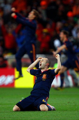 JOHANNESBURG, SOUTH AFRICA - JULY 11:  Andres Iniesta of Spain celebrates after his goal seals victory during the 2010 FIFA World Cup South Africa Final match between Netherlands and Spain at Soccer City Stadium on July 11, 2010 in Johannesburg, South Afr