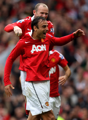 MANCHESTER, ENGLAND - SEPTEMBER 19:  Dimitar Berbatov of Manchester United celebrates scoring his team's second goal with team mate Wayne Rooney during the Barclays Premier League match between Manchester United and Liverpool at Old Trafford on September