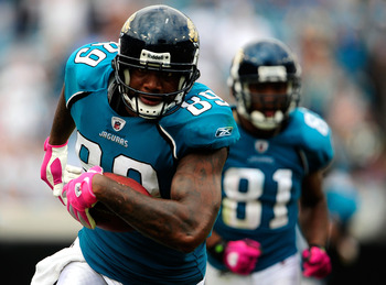 JACKSONVILLE, FL - OCTOBER 04:  Marcedes Lewis #89 of the Jacksonville Jaguars runs for a touchdown during the game against the Tennessee Titans at Jacksonville Municipal Stadium on October 4, 2009 in Jacksonville, Florida.  (Photo by Sam Greenwood/Getty