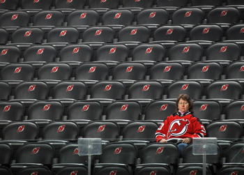 NEWARK, NJ - DECEMBER 17: A fan watches warmups prior to the game between the New Jersey Devils and the Nashville Predators at the Prudential Center on December 17, 2010 in Newark, New Jersey.  (Photo by Bruce Bennett/Getty Images)
