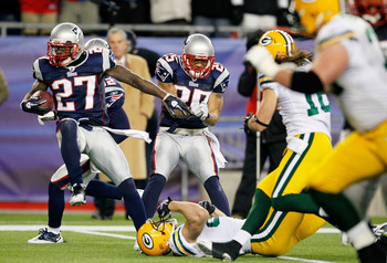 FOXBORO, MA - DECEMBER 19:  Cornerback Kyle Arrington #27 of the New England Patriots scores a touchdown after intercepting the ball and running 36 yards against the Green Bay Packers during the third quarter of the game at Gillette Stadium on December 19