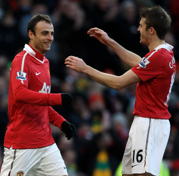 MANCHESTER, ENGLAND - NOVEMBER 27:  Dimitar Berbatov (L) of Manchester United is congratulated by team mate Michael Carrick after scoring the opening goal during the Barclays Premier League match between Manchester United and Blackburn Rovers at Old Traff