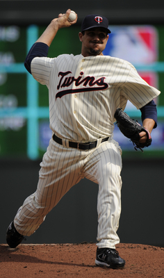 MINNESOTA, MN - APRIL 12: Carl Pavano #48 of the Minnesota Twins pitches in the first inning against the Boston Red Sox during the Twins home opener at Target Field on April 12, 2010 in Minneapolis, Minnesota. (Photo by Hannah Foslien /Getty Images)