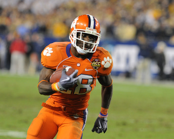 TAMPA, FL - NOVEMBER 28:  Running C. J. Spiller #28 of the Clemson Tigers rushes upfield against the Georgia Tech Yellow Jackets in the 2009 ACC Football Championship Game at Raymond James Stadium on December 5, 2009 in Tampa, Florida.  (Photo by Al Messe