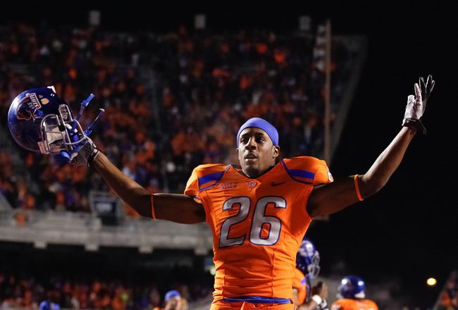 BOISE, ID - NOVEMBER 19:  Quaylon Ewing-Burton #26 of the Boise State Broncos psyches up the crowd before the game against the Fresno State Bulldogs at Bronco Stadium on November 19, 2010 in Boise, Idaho.  (Photo by Otto Kitsinger III/Getty Images)