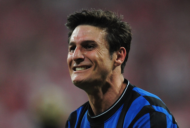 MADRID, SPAIN - MAY 22:  Javier Zanetti  of Inter Milan celebrates victory after the UEFA Champions League Final match between FC Bayern Muenchen and Inter Milan at the Estadio Santiago Bernabeu on May 22, 2010 in Madrid, Spain.  (Photo by Shaun Botterill